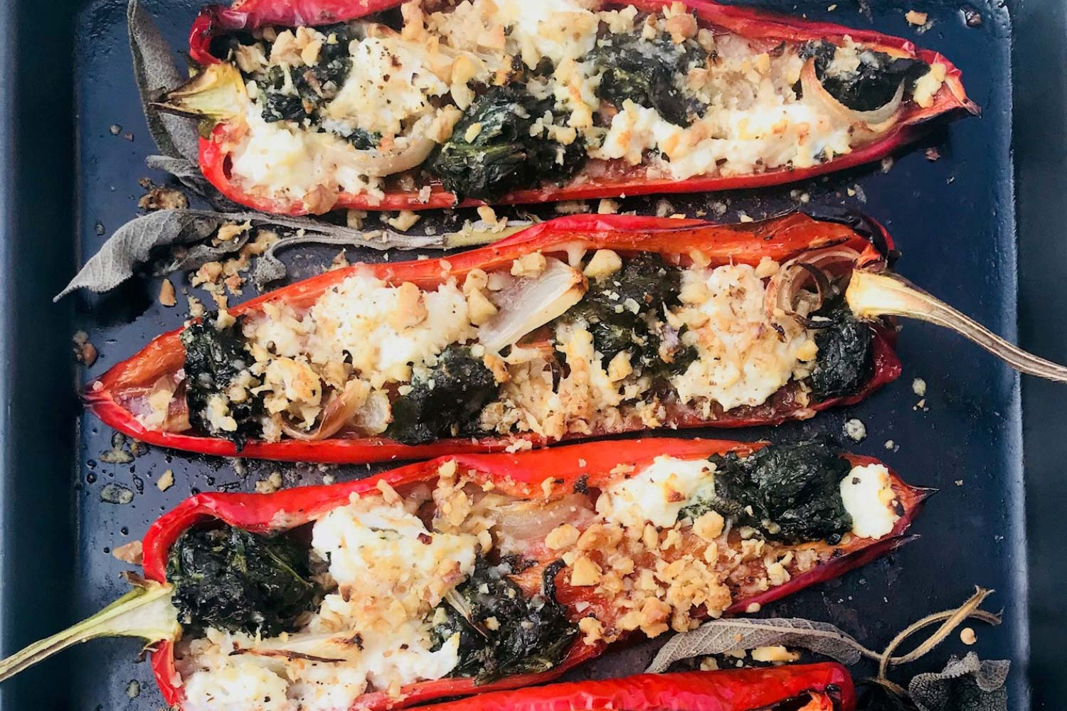 Pomora Romana Peppers with garlic oil, spinach and ricotta